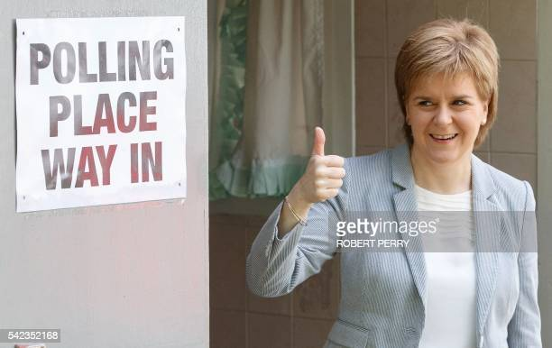 Scotland's First Minister and Leader of the Scottish National Party Nicola Sturgeon poses for photographers as leaves after voting at a polling...