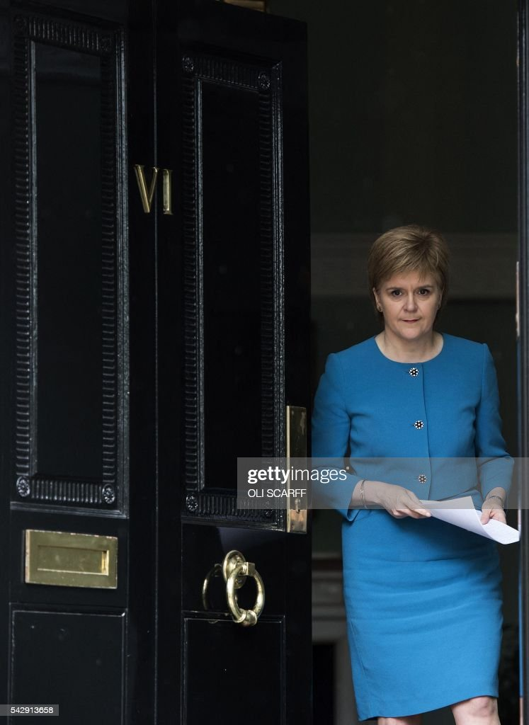 Scotland's First Minister and Leader of the Scottish National Party (SNP), Nicola Sturgeon, arrives to address the media after holding an emergency Cabinet meeting at Bute House in Edinburgh, Scotland on June 25, 2016, following the pro-Brexit result of the UK's EU referendum vote. The result of Britain's June 23 referendum vote to leave the European Union (EU) has pitted parents against children, cities against rural areas, north against south and university graduates against those with fewer qualifications. London, Scotland and Northern Ireland voted to remain in the EU but Wales and large swathes of England, particularly former industrial hubs in the north with many disaffected workers, backed a Brexit. / AFP / OLI