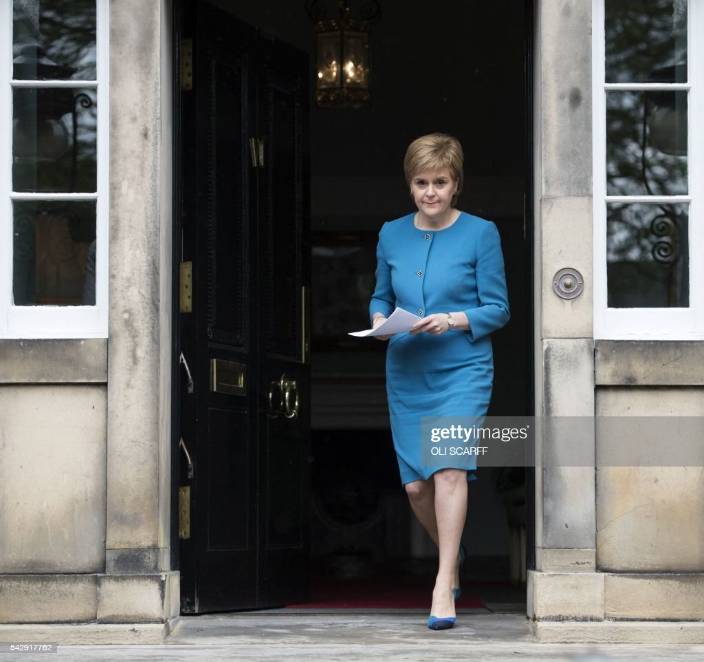 Scotland's First Minister and Leader of the Scottish National Party (SNP), Nicola Sturgeon, addresses the media after holding an emergency Cabinet meeting at Bute House in Edinburgh, Scotland on June 25, 2016, following the pro-Brexit result of the UK's EU referendum vote. The result of Britain's June 23 referendum vote to leave the European Union (EU) has pitted parents against children, cities against rural areas, north against south and university graduates against those with fewer qualifications. London, Scotland and Northern Ireland voted to remain in the EU but Wales and large swathes of England, particularly former industrial hubs in the north with many disaffected workers, backed a Brexit. / AFP / OLI