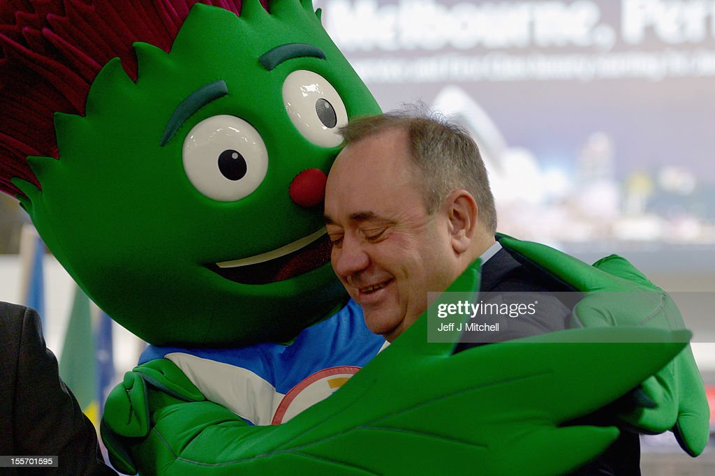 Scotland's First Minister and Scottish National Party leader, <a gi-track='captionPersonalityLinkClicked' href=/galleries/search?phrase=Alex+Salmond&family=editorial&specificpeople=857688 ng-click='$event.stopPropagation()'>Alex Salmond</a>, receives a hug from Clyde the mascot as he attends a Commonwealth Games event at Glasgow Airport, as he completes 2,002 full days in office, making him the longest-serving first minister on November 7, 2012 in Glasgow,Scotland. Mr Salmond attended a range of engagements in Edinburgh and Glasgow, outlining how his strong team of ministers is delivering results for Scotland every day and the vision his government has to make Scotland a more successful place.