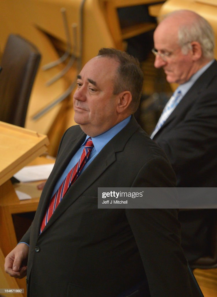 Scotland's First Minister and Scottish National Party leader <a gi-track='captionPersonalityLinkClicked' href=/galleries/search?phrase=Alex+Salmond&family=editorial&specificpeople=857688 ng-click='$event.stopPropagation()'>Alex Salmond</a> attends the Scottish Parliament on October 24, 2012 in Edinburgh, Scotland. Salmond has been accused by opposition parties of misleading his voters over legal advice given to the Scottish government about Scotland's right to join the European Union.