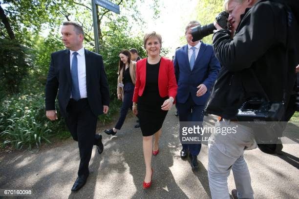 Scotland's First Minister and Scottish National Party leader Nicola Sturgeon walks with deputy leader and member of parliament Angus Robertson during...
