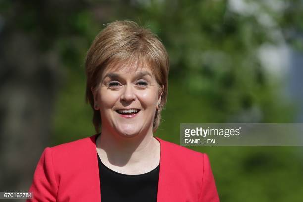 Scotland's First Minister and Scottish National Party leader Nicola Sturgeon attends a media facility outside the Houses of Parliament in central...