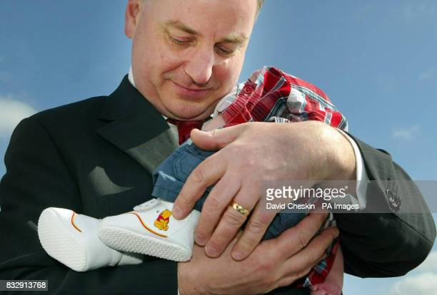 Scotland's First Minister Jack McConnell holds a baby as he spends Easter Saturday out on the campaign trail meeting voters at the iconic Falkirk...