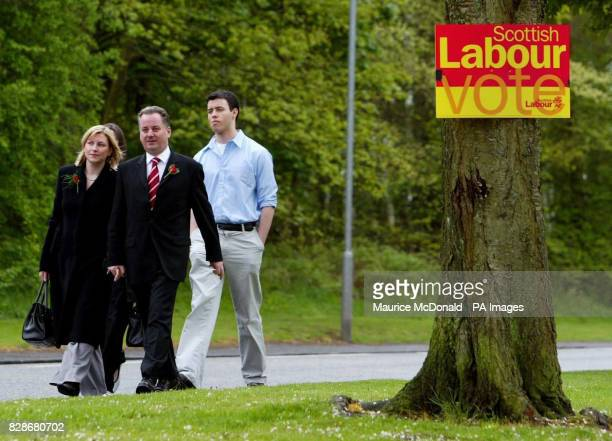 Scotland's first minister Jack McConnell with his wife Bridget son Mark and daughter Hannah arriving at Carrick Hall in Wishaw to cast his vote in...