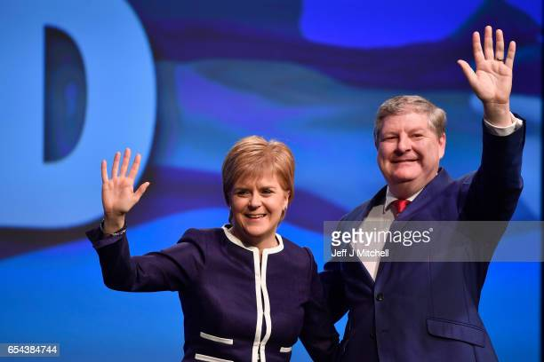 Scotland's First Minister Nicola Sturgeon and Angus Robertson deputy SNP leader acknowledge applause after addressing delegates at the SNP spring...