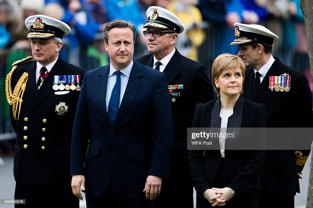 Scotland's First Minister <a gi-track='captionPersonalityLinkClicked' href=/galleries/search?phrase=Nicola+Sturgeon&family=editorial&specificpeople=2582617 ng-click='$event.stopPropagation()'>Nicola Sturgeon</a> (R) and British Prime Minister <a gi-track='captionPersonalityLinkClicked' href=/galleries/search?phrase=David+Cameron+-+Politiker&family=editorial&specificpeople=227076 ng-click='$event.stopPropagation()'>David Cameron</a> attend attend commemorations of the 100th anniversary of the Battle of Jutland at St Magnus Cathedral on May 31, 2016 in Kirkwall, Scotland. The event marks the centenary of the largest naval battle of World War One where more than 6,000 Britons and 2,500 Germans died in the Battle of Jutland fought near the coast of Denmark on 31 May and 1 June 1916.