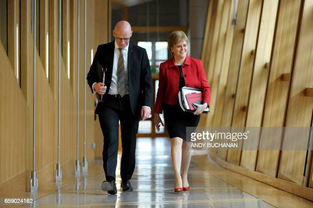 Scotland's First Minister Nicola Sturgeon and Deputy First Minister John Swinney arrive to attend the second day of the 'Scotland's Choice' debate on...