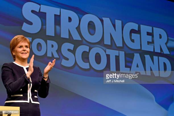Scotland's First Minister Nicola Sturgeon arrives on stage to listen to Angus Robertson SNP deputy leader addressing delegates at the spring...