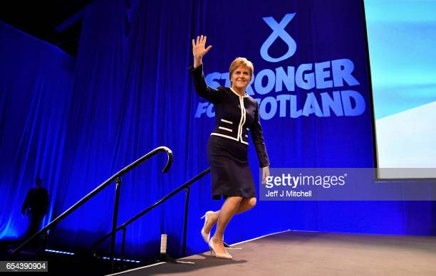 Scotland's First Minister Nicola Sturgeon arrives on stage to listen to Angus Robertson deputy SNP leader addressing delegates at the spring SNP...