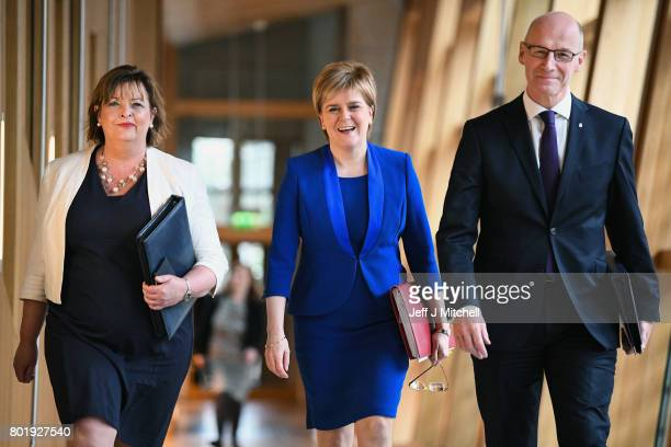 Scotland's First Minister Nicola Sturgeon arrives with John Swinney and Fiona Hyslop before making an announcement to parliament regarding a second...