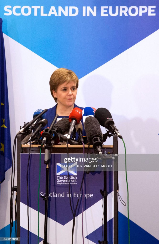 Scotland's First Minister Nicola Sturgeon delivers a speech during a media conference at the Scotland House in Brussels as she is on a one day visit to meet with EU officials, on June 29, 2016. Scotland's First Minister Nicola Sturgeon said she was 'heartened' by her talks with EU officials today but said there was no 'automatic easy path' to protecting her country's status in the EU after Brexit. / AFP / POOL / Geoffroy Van der Hasselt