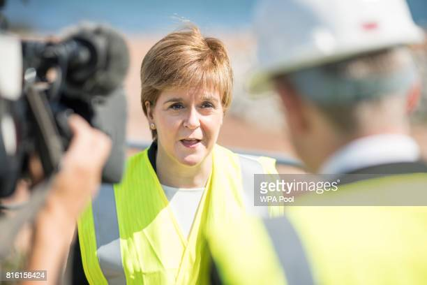 Scotland's First Minister Nicola Sturgeon during her visit to the site of Aberdeen Harbour's expansion into Nigg Bay on July 17 2017 in Aberdeen...