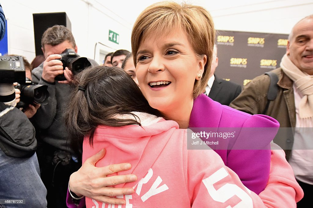 Scotland's First Minister Nicola Sturgeon, hugs a girl following giving a speech setting out the SNP's plans to reduce child poverty at Forestbank Community Centre on April 7, 2015 in Livingston, Scotland.The First Minister announced that SNP MP's will use their influence after May's election to combat child poverty in Scotland and across the UK.