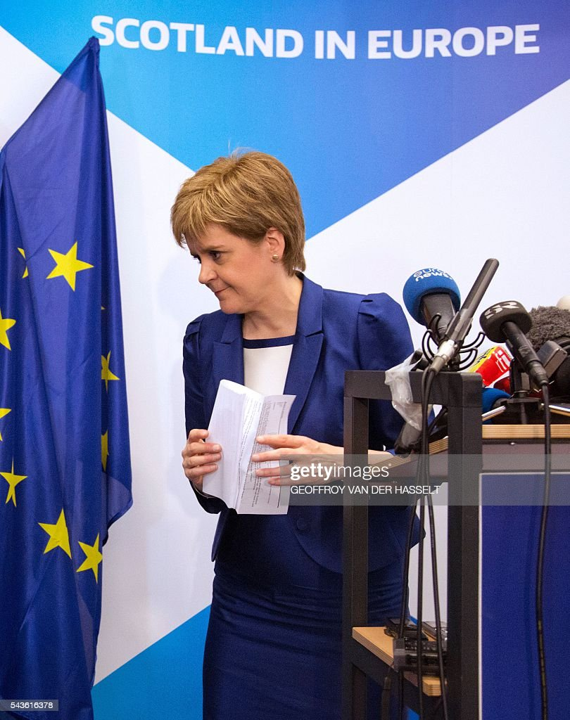 Scotland's First Minister Nicola Sturgeon leaves after a media conference at the Scotland House in Brussels as she is on a one day visit to meet with EU officials, on June 29, 2016. Scotland's First Minister Nicola Sturgeon said she was 'heartened' by her talks with EU officials today but said there was no 'automatic easy path' to protecting her country's status in the EU after Brexit. / AFP / POOL / Geoffroy Van der Hasselt
