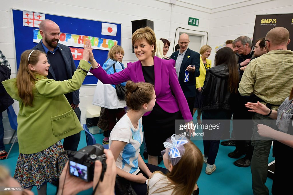 Scotland's First Minister <a gi-track='captionPersonalityLinkClicked' href=/galleries/search?phrase=Nicola+Sturgeon&family=editorial&specificpeople=2582617 ng-click='$event.stopPropagation()'>Nicola Sturgeon</a> meets activists following her speech setting out the SNP's plans to reduce child poverty at Forestbank Community Centre on April 7, 2015 in Livingston, Scotland.The First Minister announced that SNP MP's will use their influence after May's election to combat child poverty in Scotland and across the UK.
