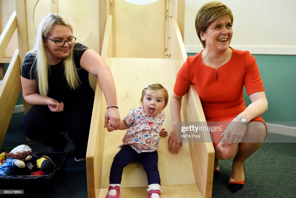 Scotland's First Minister Nicola Sturgeon (R) meets children and staff during a visit to the Buttterfly Nursery on August 16, 2017in Glasgow, Scotland.