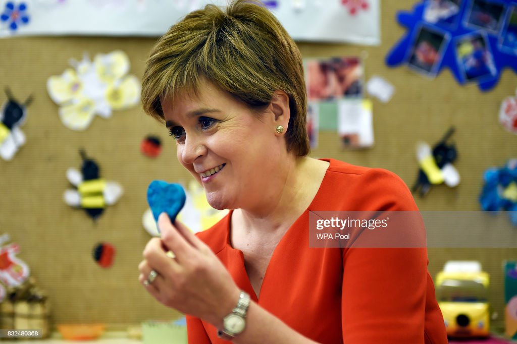 Scotland's First Minister Nicola Sturgeon meets children and staff during a visit to the Buttterfly Nursery on August 16, 2017in Glasgow, Scotland.