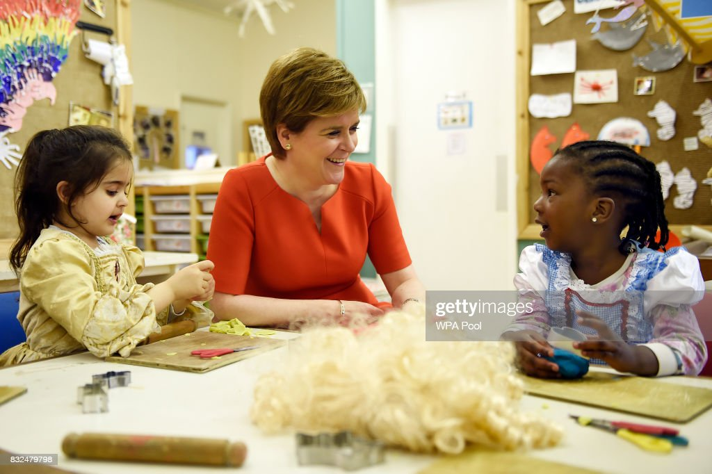 Scotland's First Minister Nicola Sturgeon (R) meets children during a visit to the Buttterfly Nursery on August 16, 2017in Glasgow, Scotland.