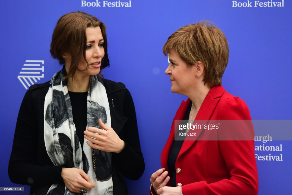 Scotland's First Minister Nicola Sturgeon (R) poses for photographs with author Elif Shafak (C) during the Edinburgh International Book Festival on August 18, 2017 in Edinburgh, Scotland. Both were taking part in a Book Festival talk on 'Life Under Public Scrutiny'.
