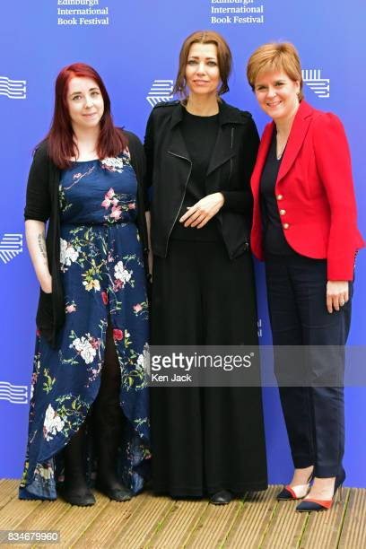 Scotland's First Minister Nicola Sturgeon poses for photographs with author Elif Shafak and publisher Heather McDaid during the Edinburgh...