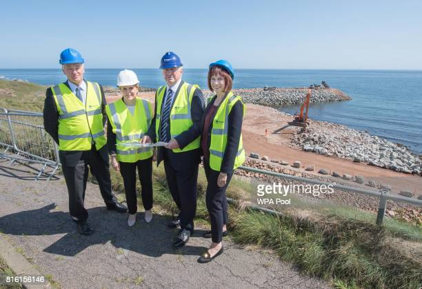 Scotland's First Minister Nicola Sturgeon poses with Chief Executive of Aberdeen Harbour Colin Parker Chairman of Aberdeen Harbour Board Alistair...