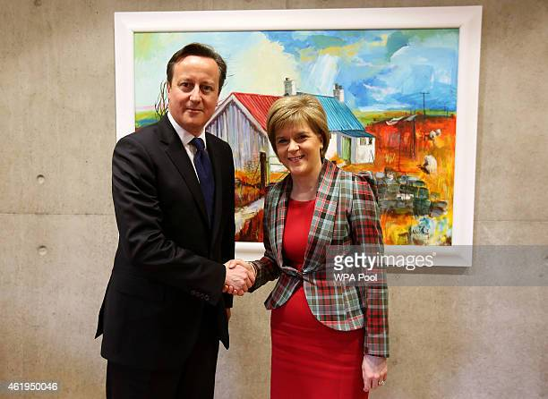 Scotland's First Minister Nicola Sturgeon shakes hands with Prime Minister David Cameron in her office at the Scottish Parliament on January 22 2015...