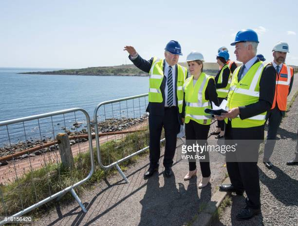 Scotland's First Minister Nicola Sturgeon speaks with Chairman of Aberdeen Harbour Board Alistair Mackenzie and Chief Executive of Aberdeen Harbour...