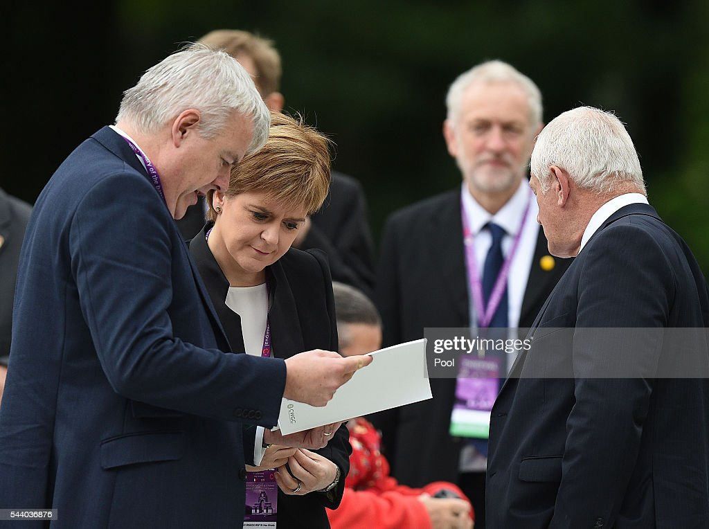 Scotland's First Minister <a gi-track='captionPersonalityLinkClicked' href=/galleries/search?phrase=Nicola+Sturgeon&family=editorial&specificpeople=2582617 ng-click='$event.stopPropagation()'>Nicola Sturgeon</a> stands with First Minister of Wales Carwyn Jones, watched by Labour Party leader Jeremy Corbyn (second right), as they wait to take their seats at the Commemoration of the Centenary of the Battle of the Somme at the Commonwealth War Graves Commission Thiepval Memorial on July 1, 2016 in Thiepval, France. The event is part of the Commemoration of the Centenary of the Battle of the Somme at the Commonwealth War Graves Commission Thiepval Memorial in Thiepval, France, where 70,000 British and Commonwealth soldiers with no known grave are commemorated.