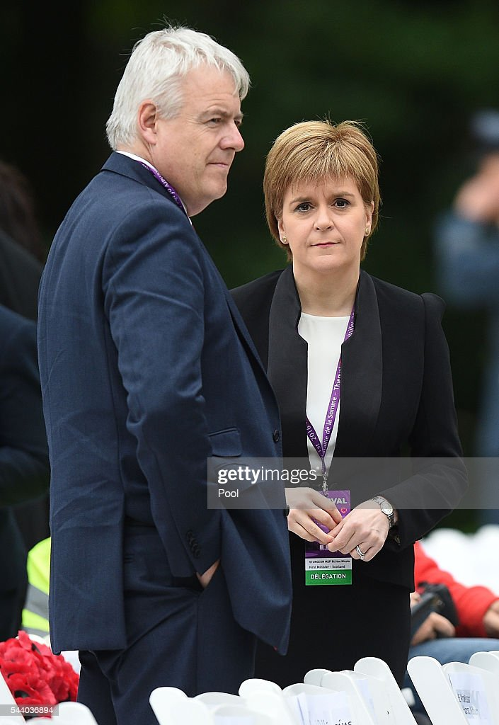 Scotland's First Minister <a gi-track='captionPersonalityLinkClicked' href=/galleries/search?phrase=Nicola+Sturgeon&family=editorial&specificpeople=2582617 ng-click='$event.stopPropagation()'>Nicola Sturgeon</a> stands with First Minister of Wales Carwyn Jones as they wait to take their seats at the Commemoration of the Centenary of the Battle of the Somme at the Commonwealth War Graves Commission Thiepval Memorial on July 1, 2016 in Thiepval, France. The event is part of the Commemoration of the Centenary of the Battle of the Somme at the Commonwealth War Graves Commission Thiepval Memorial in Thiepval, France, where 70,000 British and Commonwealth soldiers with no known grave are commemorated.