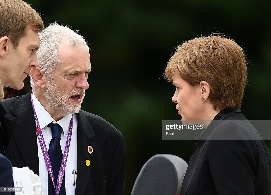 Scotland's First Minister <a gi-track='captionPersonalityLinkClicked' href=/galleries/search?phrase=Nicola+Sturgeon&family=editorial&specificpeople=2582617 ng-click='$event.stopPropagation()'>Nicola Sturgeon</a> talks with Labour Party leader <a gi-track='captionPersonalityLinkClicked' href=/galleries/search?phrase=Jeremy+Corbyn&family=editorial&specificpeople=2596361 ng-click='$event.stopPropagation()'>Jeremy Corbyn</a> (second left), as they wait to take their seats at the Commemoration of the Centenary of the Battle of the Somme at the Commonwealth War Graves Commission Thiepval Memorial on July 1, 2016 in Thiepval, France. The event is part of the Commemoration of the Centenary of the Battle of the Somme at the Commonwealth War Graves Commission Thiepval Memorial in Thiepval, France, where 70,000 British and Commonwealth soldiers with no known grave are commemorated.