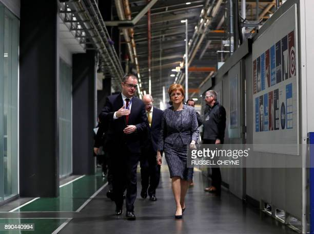 Scotland's First Minister Nicola Sturgeon visits the Rolls Royce plant at Inchinnan Scotland Britain December 11 2017 / AFP PHOTO / POOL / RUSSELL...