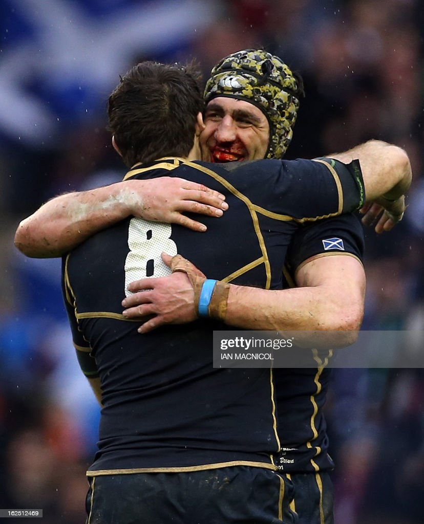 Scotland's flanker and captain Kelly Brown (R) embraces Scotland's number 8 Johnnie Beattie after their victory in the Six Nations international rugby union match between Scotland and Ireland at Murrayfield Stadium in Edinburgh on February 24, 2013.