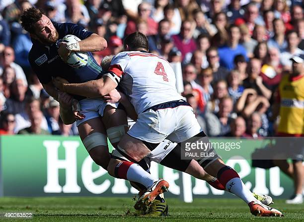 Scotland's flanker Ryan Wilson is tackled by US lock Hayden Smith during a Pool B match of the 2015 Rugby World Cup between Scotland and USA at...
