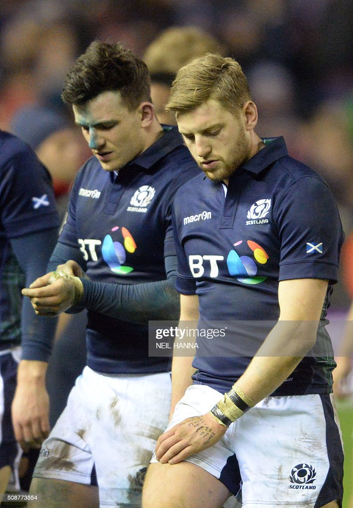 Scotland's fly half Finn Russell and Scotland's centre <a gi-track='captionPersonalityLinkClicked' href=/galleries/search?phrase=Matt+Scott+-+Rugby+Union+Player&family=editorial&specificpeople=15066775 ng-click='$event.stopPropagation()'>Matt Scott</a> react following during the Six Nations international rugby union match between Scotland and England at Murrayfield in Edinburgh, Scotland on Febuary 6, 2016. England won the match 15-9. / AFP / NEIL