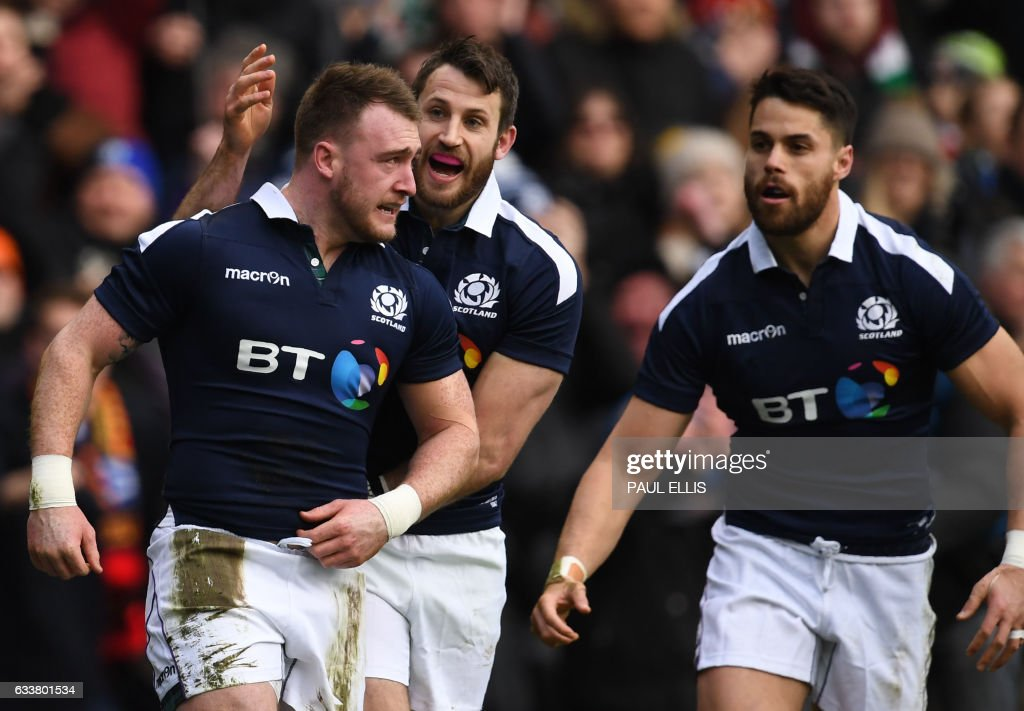 Scotland's full back Stuart Hogg (L) celebrates after scoring their first try during the Six Nations international rugby union match between Scotland and Ireland at Murrayfield in Edinburgh, Scotland on February 4, 2017. / AFP / Paul ELLIS