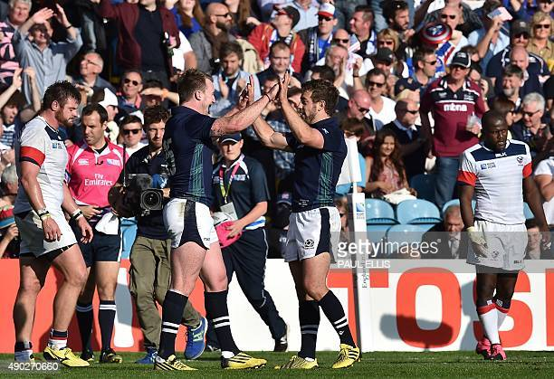 Scotland's fullback Stuart Hogg and Scotland's scrum half Greig Laidlaw celebrate after winning a Pool B match of the 2015 Rugby World Cup between...