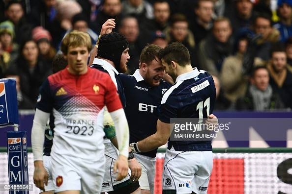 Scotland's fullback Stuart Hogg celebrates after scoring a try with his teammate Scotland's wing Tommy Seymour during the Six Nations international...