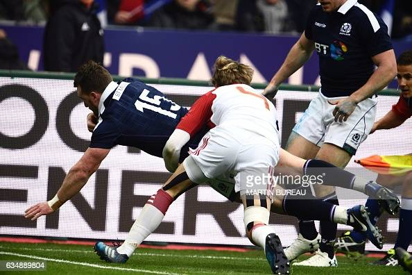 Scotland's fullback Stuart Hogg scores a try during the Six Nations international rugby union match between France and Scotland at the Stade de...