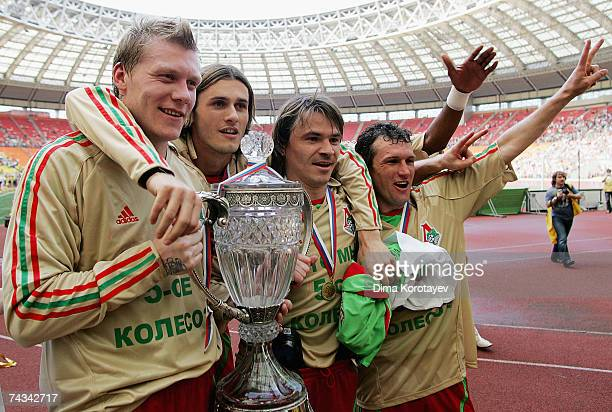 Scotland's Garry O'Connor Marjan Had Dmitri Loskov and Sergei Gurenko of Lokomotiv Moscow celebrate victory in the Russian Cup final match between...