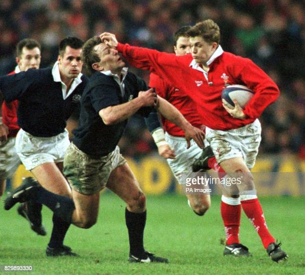 Scotland's Gary Armstrong gets it in the face from the Welsh standoff Arwel Thomas during todays Internation at Murrayfield Photo by Owen Humphreys/PA