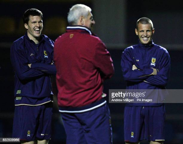 Scotland's Gary Caldwell and Kenny Miller with manager Walter Smith during a training session at the Bannikov stadium Kiev Ukraine