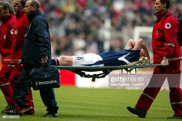 Scotland's Gary Holt is taken off the pitch on a stretcher after a bad challenge