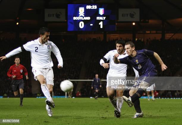 Scotland's Gary Naysmith challenges Italy's Rino Gattuso during the Euro Qualifier Scotland vs Italy at Hampden