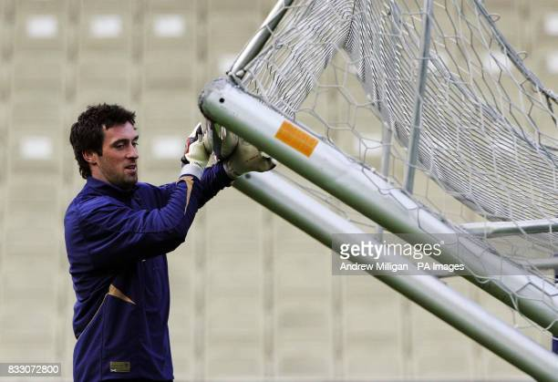 Scotland's goal keeper Alan McGregor moves the goal posts during a training session at the Gerhard Hanappi Stadium Vienna Austria