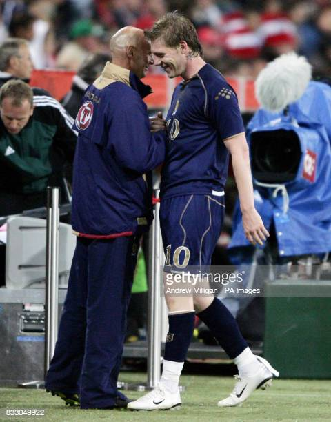 Scotland's goalscorer Garry O'Connor shakes hands with coach Andy Watson after his substitution during the International Friendly against Austriaat...