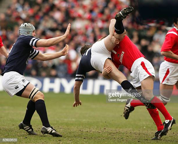 Scotland's Gordon Bulloch is upended by Dwayne Peel of Wales during the RBS Six Nations International between Scotland and Wales at Murrayfield on...