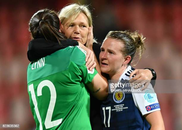 Scotland's head coach Anna Signeul hugs Scotland's defender Frankie Brown and goalkeeper Shannon Lynn after they won the UEFA Women's Euro 2017...