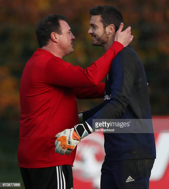 Scotland's interim manager Malky MacKay is seen with Craig Gordon during a training session at Orium sporting centre of excellence on November 6 2017...