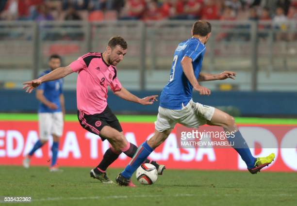 Scotland's James McArthur vies with Italy's Giorgio Chiellini during the International friendly football match Italy vs Scotland at the National...